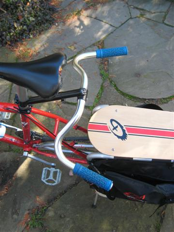 "Nitto swept-back (Dove bar) on xtracycle in upside-down 'moustache bar configuration. You can also run them ""up."""